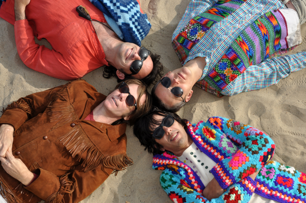 Beachwood Sparks lying on the beach